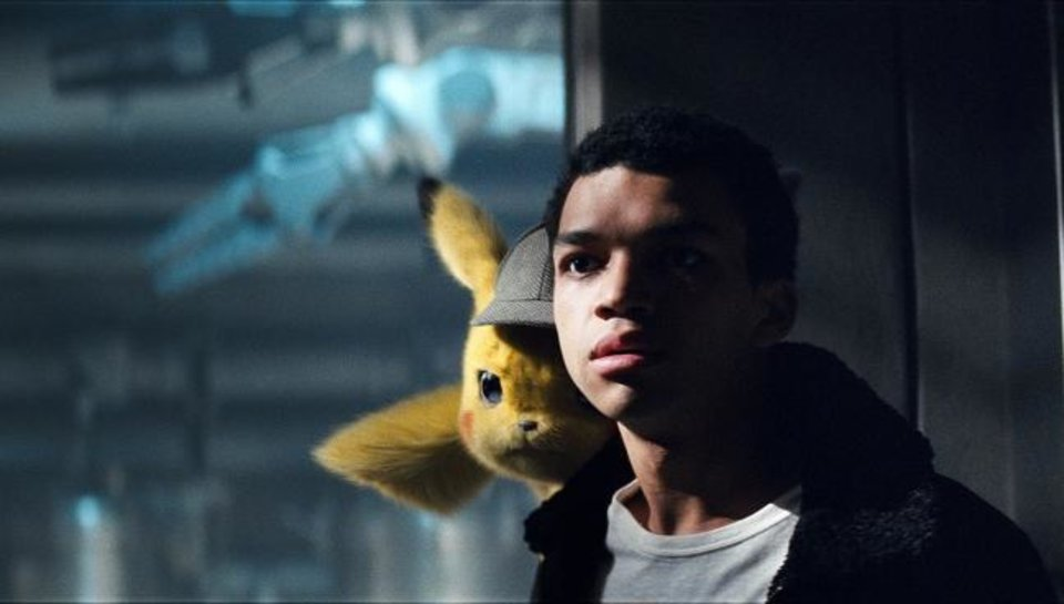 Photo -  Justice Smith, right, stars with Pikachu (voice of Ryan Reynolds) in