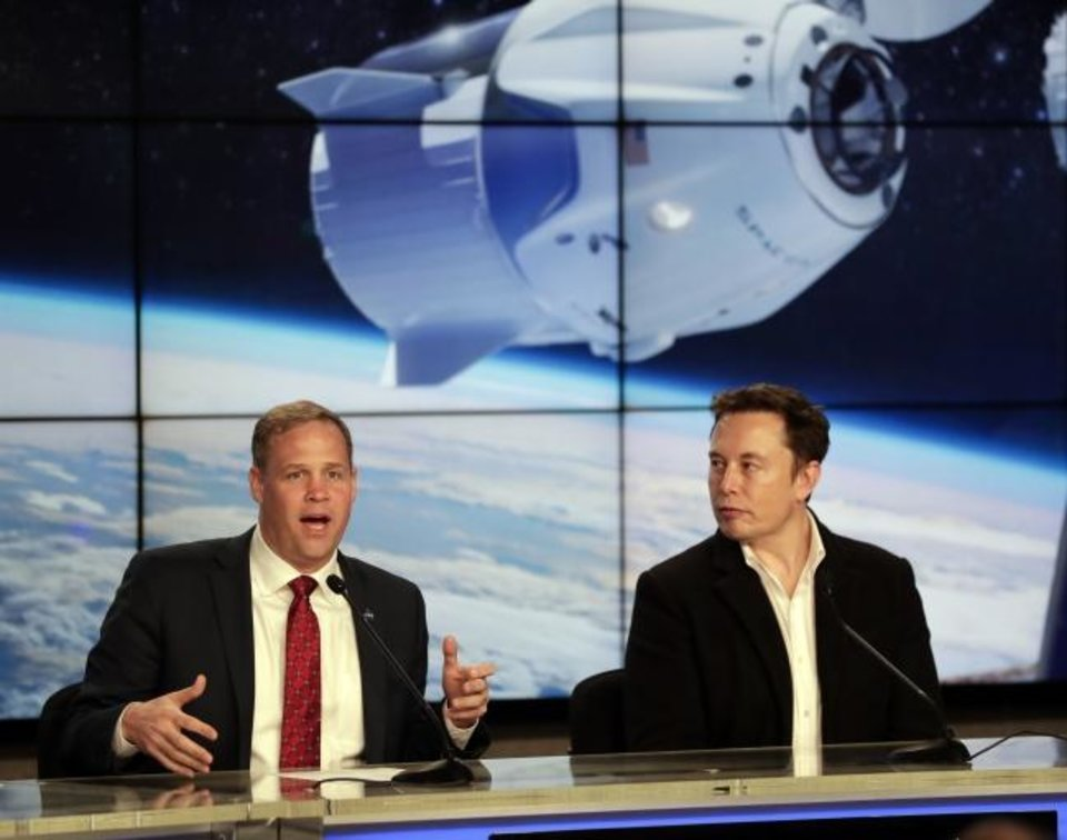 Photo -  NASA Administrator Jim Bridenstine, left, and Elon Musk, CEO of SpaceX, answer questions during a news conference after the SpaceX Falcon 9 Demo-1 launch at the Kennedy Space Center in Cape Canaveral earlier this year. [John Raoux/AP Photo]