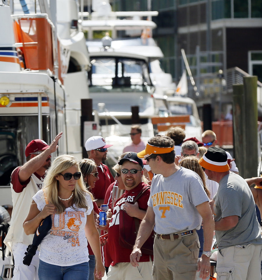 Photo - OU and Tennessee fans along the Tennessee River before the college football game between the Oklahoma Sooners and the Tennessee Volunteers at Neyland Stadium in Knoxville, Tennessee, Saturday, Sept. 12, 2015. Photo by Nate Billings, The Oklahoman