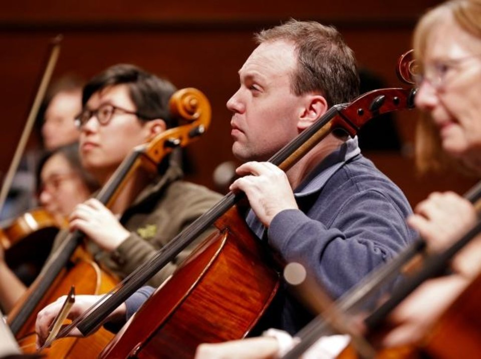 Photo -  Cellist Rob Bradshaw rehearses in 2018 with the Oklahoma City Philharmonic Orchestra. [The Oklahoman Archives]