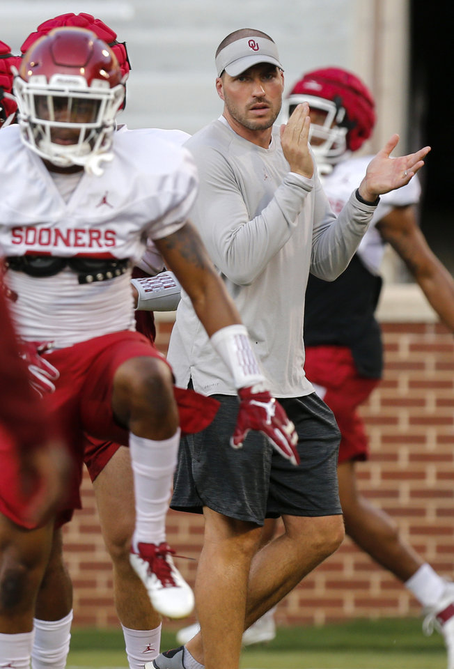 Photo - OU defensive coordinator Alex Grinch claps as players warm up during football practice for the University of Oklahoma Sooners at Gaylord Family - Oklahoma Memorial Stadium in Norman, Okla., Monday, Aug. 12, 2019. [Nate Billings/The Oklahoman]