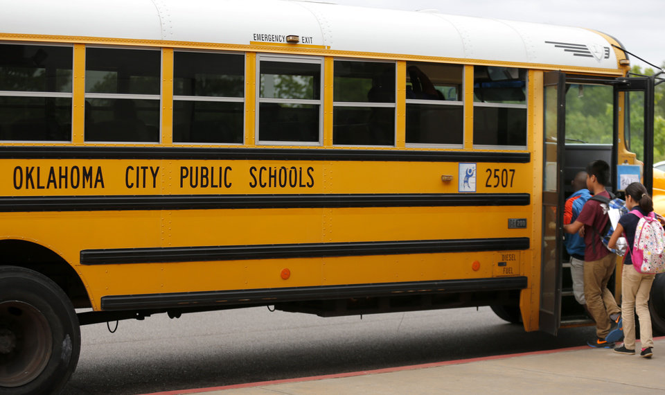 Photo -  Students board a bus at an Oklahoma City elementary school in this 2017 photo. [SARAH PHIPPS/ THE OKLAHOMAN ARCHIVES]
