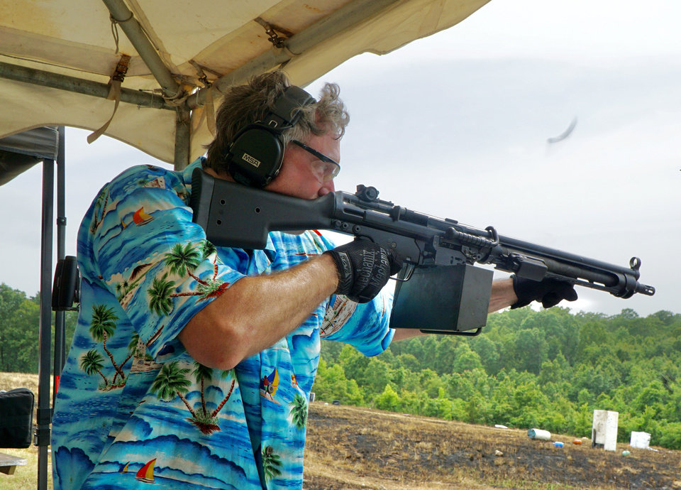 Photo - Houstin Hardin of Jackson, Mississippi, fires a machine gun Saturday at the Oklahoma Full Auto Shoot and Trade Show in Wyandotte. [Jordan Green/The Oklahoman]