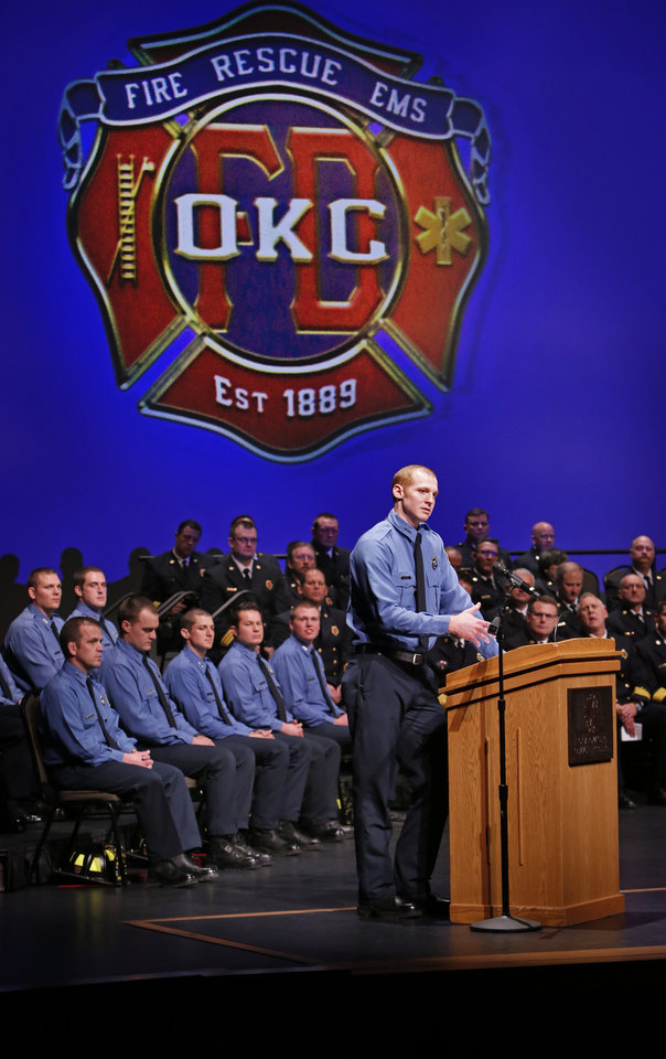 Photo -  Overall outstanding recruit Joshua Click speaks to the crowd during the Oklahoma City Fire Department Recruit Graduation ceremony on Friday at Oklahoma City Community College. [Photo by Steve Sisney, The Oklahoman]