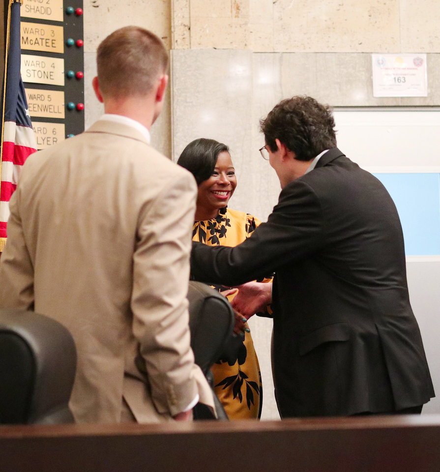 Photo - Nikki Nice greets her fellow council members after she was sworn in as new Ward 7 Oklahoma City Councilwoman, Monday, November 19, 2018.  Photo by Doug Hoke, The Oklahoman