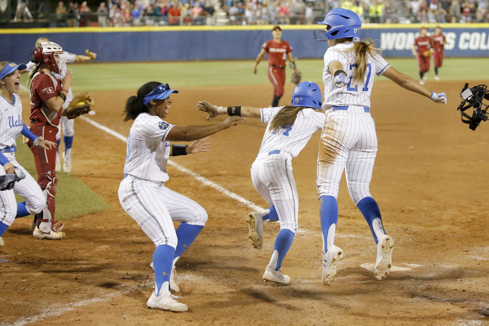 Photo - UCLA celebrates after winning the second NCAA softball game in the championship series of the Women's College World Series between Oklahoma and UCLA at USA Softball Hall of Fame Stadium in Oklahoma City, Tuesday, June 4, 2019. UCLA won 5-4. [Bryan Terry/The Oklahoman]