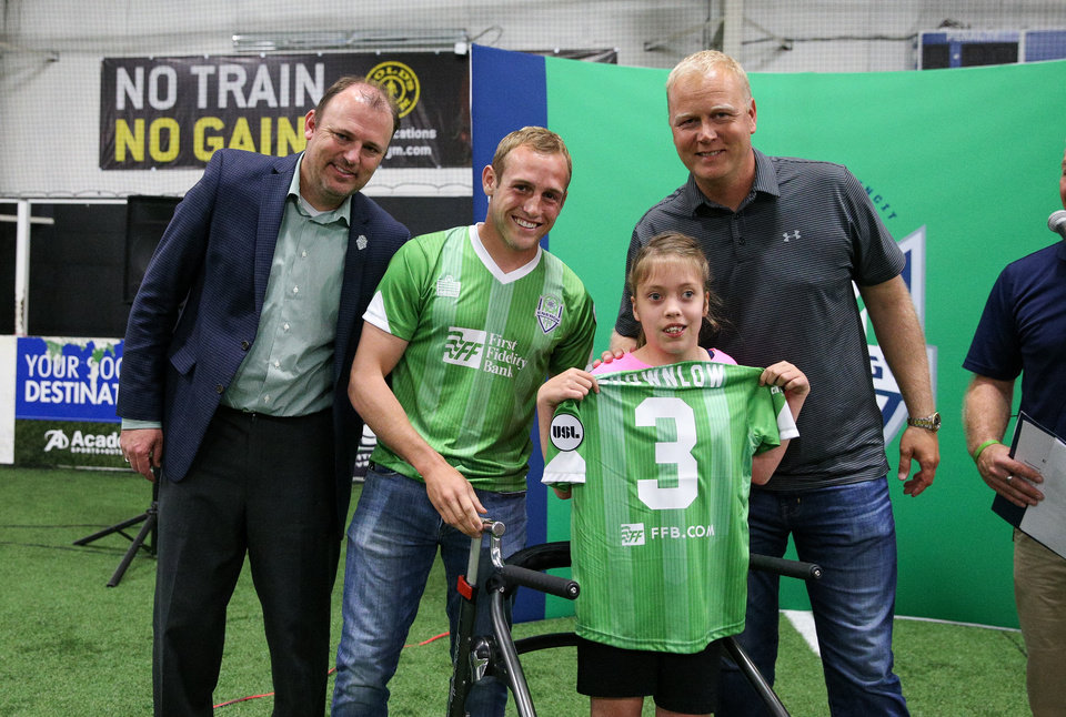 Photo - Posing like a pro: Emma at the Energy FC Sidekicks draft. Photo courtesy of Prodigal LLC.