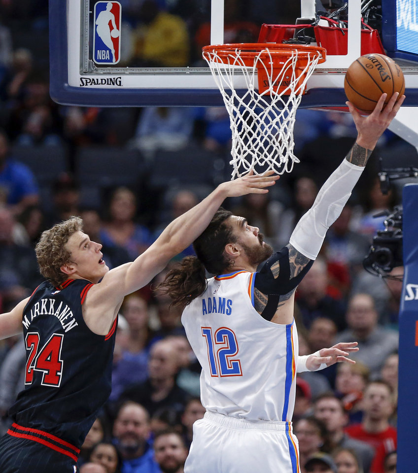 Photo - Oklahoma City's Steven Adams (12) shoots in front of Chicago's Lauri Markkanen (24) in the third quarter during an NBA basketball game between the Oklahoma City Thunder and Chicago Bulls at Chesapeake Energy Arena in Oklahoma City, Monday, Dec. 16, 2019. Oklahoma City won 109-106. [Nate Billings/The Oklahoman]
