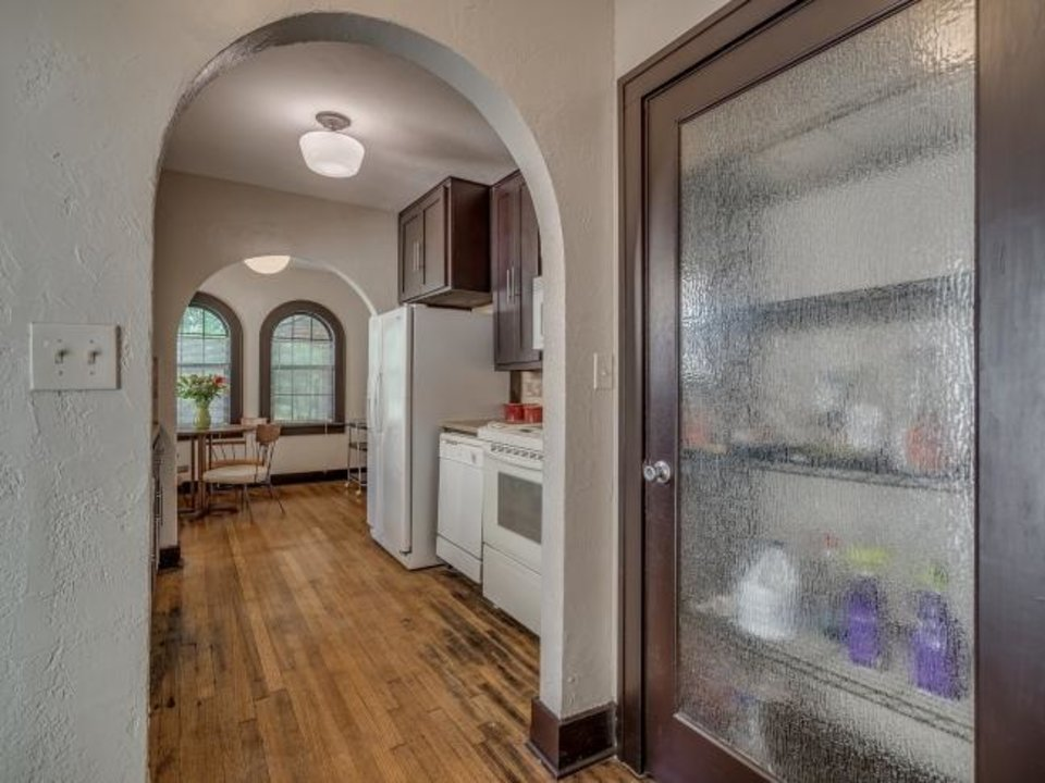 Photo -  This is the view from the pantry, through the kitchen to a dining area at 1232 NE 17. [L.D. SMITH PROPERTIES]