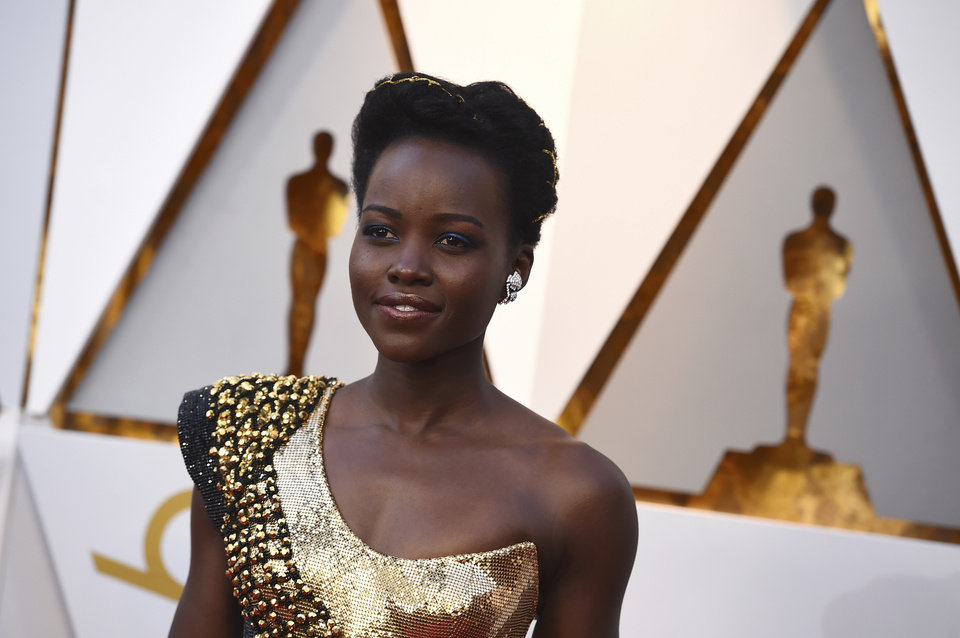 Photo - Lupita Nyong'o arrives at the Oscars on Sunday, March 4, 2018, at the Dolby Theatre in Los Angeles. (Photo by Jordan Strauss/Invision/AP)