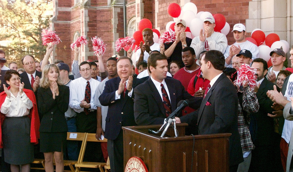 Photo - OU Athletic Director Joe Castiglione welcomes new University of Oklahoma football coach Bob Stoops.