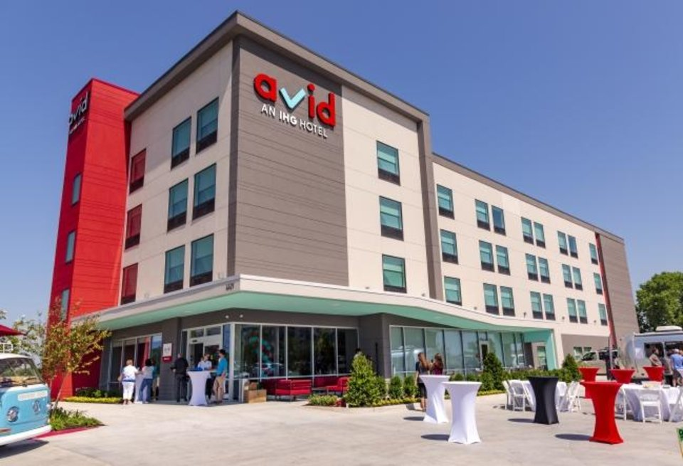 Photo -  The exterior of the new Avid Hotel is seen during its grand opening at 4621 SW 15 St. [CHRIS LANDSBERGER PHOTOS/THE OKLAHOMAN]