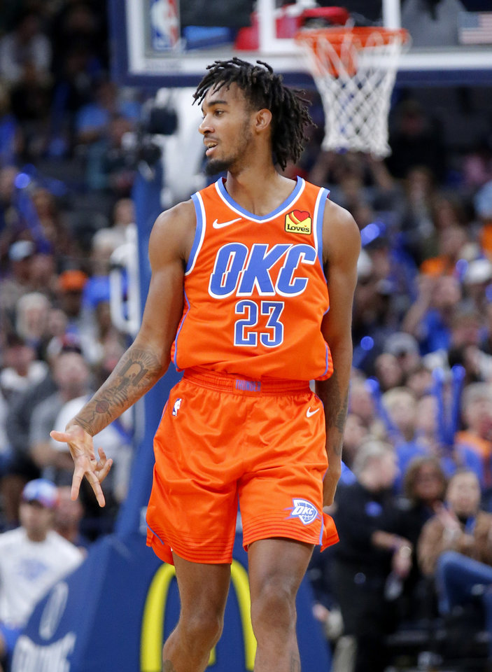 Photo - Oklahoma City's Terrance Ferguson (23) celebrates a 3-point basket during the NBA game between the Oklahoma City Thunder and the Milwaukee Bucks at Chesapeake Energy Arena,   Sunday, Nov. 10, 2019.  [Sarah Phipps/The Oklahoman]