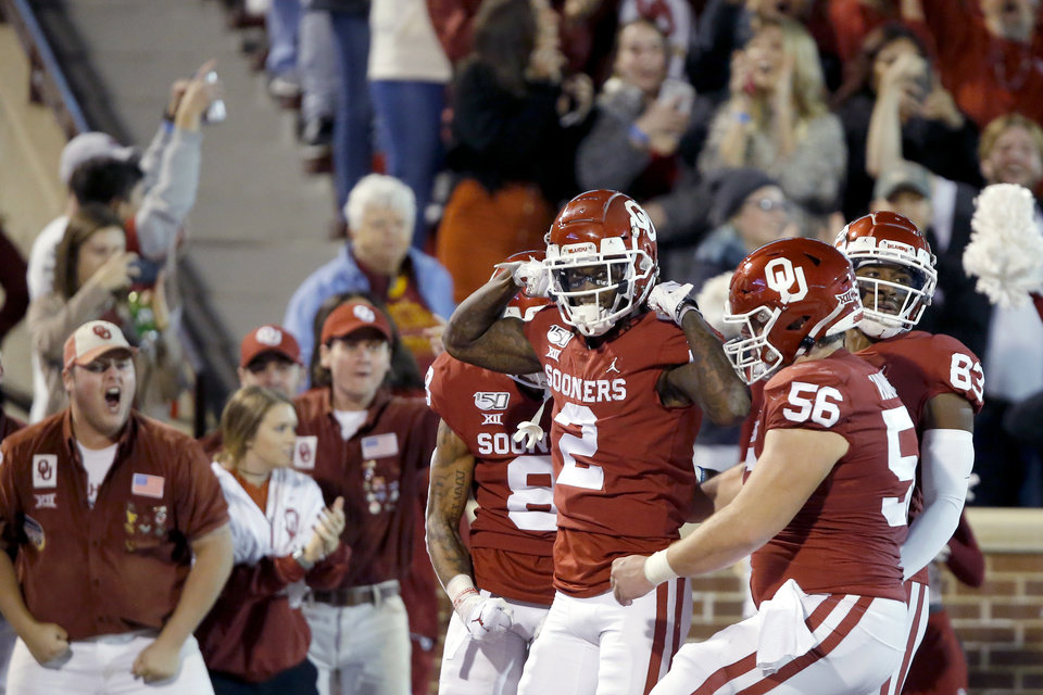 Photo - Oklahoma's CeeDee Lamb (2) celebrates after a touchdown during an NCAA football game between the University of Oklahoma Sooners (OU) and the Iowa State University Cyclones at Gaylord Family-Oklahoma Memorial Stadium in Norman, Okla., Saturday, Nov. 9, 2019. [Bryan Terry/The Oklahoman]