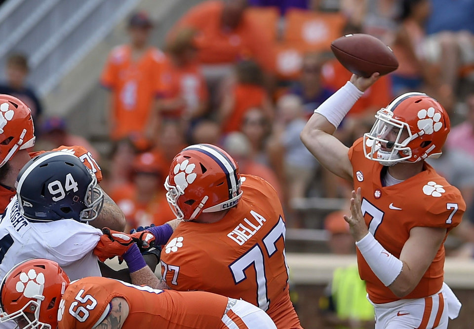Photo - FILE - In this Sept. 15, 2018, file photo, Clemson quarterback Chase Brice delivers a pass as Zach Giella (77) blocks during the second half of an NCAA college football game in Clemson, S.C. Clemson tight end Braden Galloway and offensive lineman Zach Giella will miss next season after an NCAA panel rejected the school's appeal of their drug suspension. Clemson athletic spokesman Jeff Kallin said the school learned of the NCAA's decision on Wednesday, May 22, 2019. (AP Photo/Richard Shiro, File)