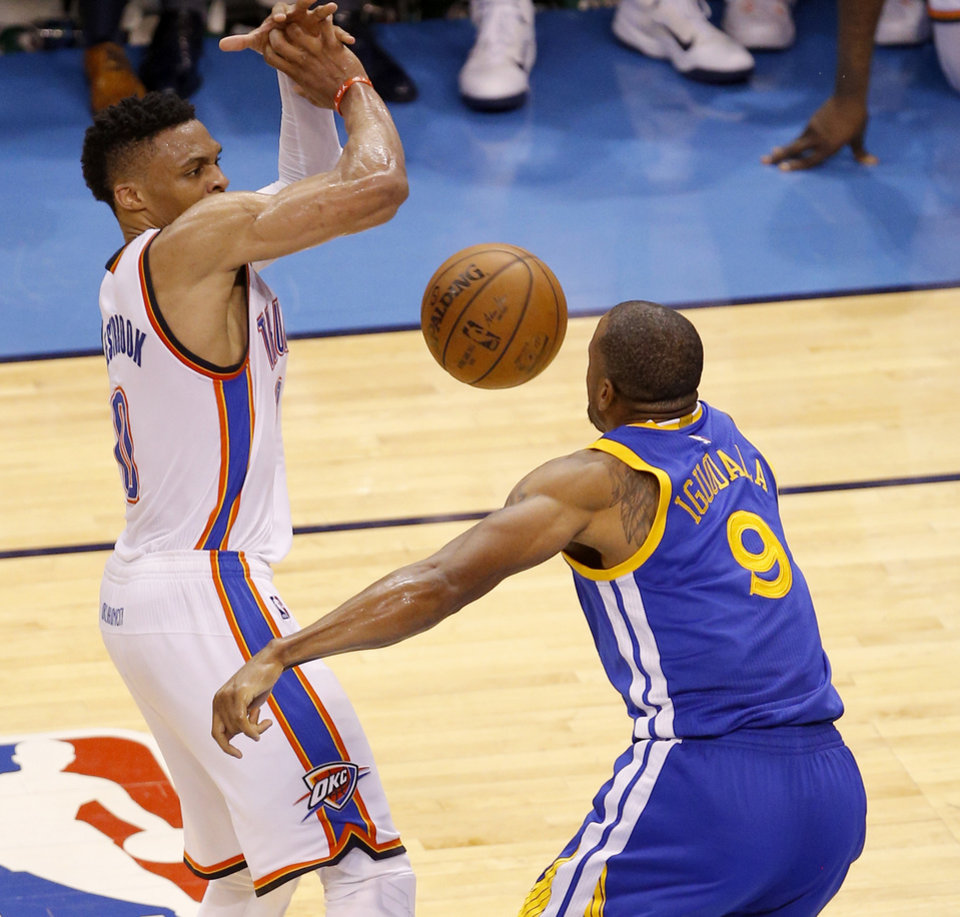 Photo - Oklahoma City's Russell Westbrook (0) loses the ball beside Golden State's Andre Iguodala (9) late in Game 6 of the Western Conference finals in the NBA playoffs between the Oklahoma City Thunder and the Golden State Warriors at Chesapeake Energy Arena in Oklahoma City, Saturday, May 28, 2016. Photo by Bryan Terry, The Oklahoman