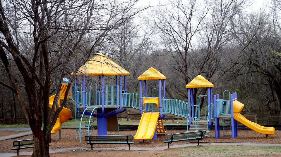 Photo - Empty playground equipment is pictured at Hafer Park is pictured in Edmond, Okla., Tuesday, March 17, 2020. [Sarah Phipps/The Oklahoman]