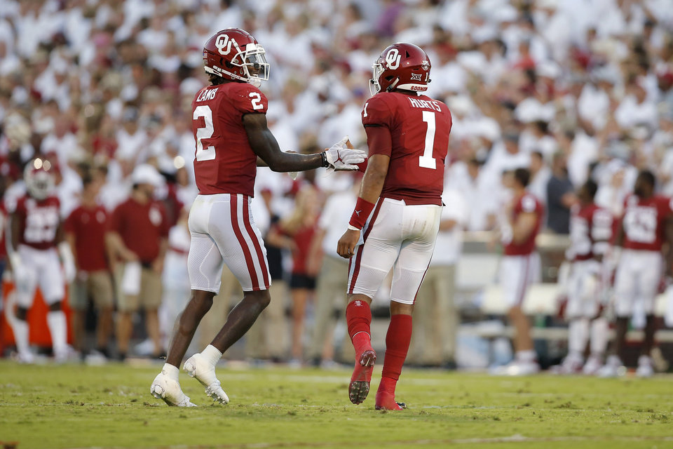 Photo - Oklahoma's Jalen Hurts (1) celebrates with CeeDee Lamb (2) after a touchdown during a college football game between the University of Oklahoma Sooners (OU) and the Houston Cougars at Gaylord Family-Oklahoma Memorial Stadium in Norman, Okla., Sunday, Sept. 1, 2019. [Bryan Terry/The Oklahoman]