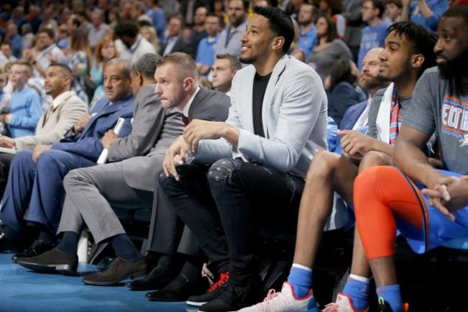 Photo -  Andre Roberson sits on the bench, next to Terrance Ferguson, during a game in March. [Bryan Terry/The Oklahoman]