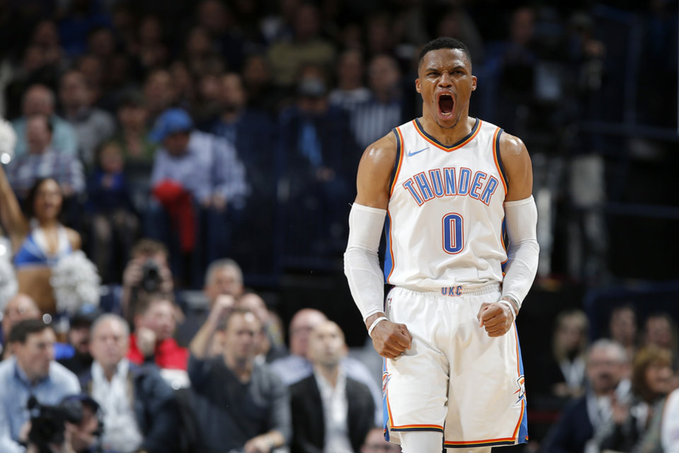 Oklahoma City's Russell Westbrook (0) celebrates a basket during an NBA basketball  game between