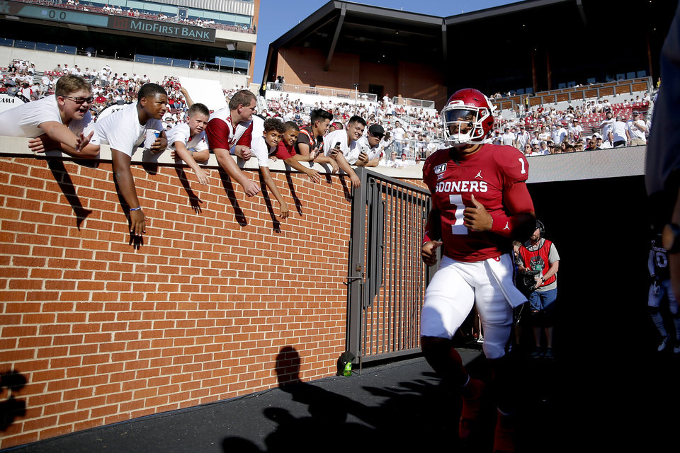 Photo - Oklahoma's Jalen Hurts (1) takes the field to warm up before a college football game between the University of Oklahoma Sooners (OU) and the Houston Cougars at Gaylord Family-Oklahoma Memorial Stadium in Norman, Okla., Sunday, Sept. 1, 2019. [Bryan Terry/The Oklahoman]