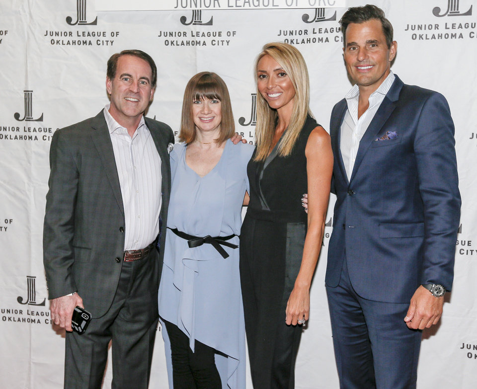 Photo -  Dirk and S.J. O'Hara, of Norman, pose for a picture with celebrities Giuliana and Bill Rancic after the Rancics' presentation at the Junior League of Oklahoma City's