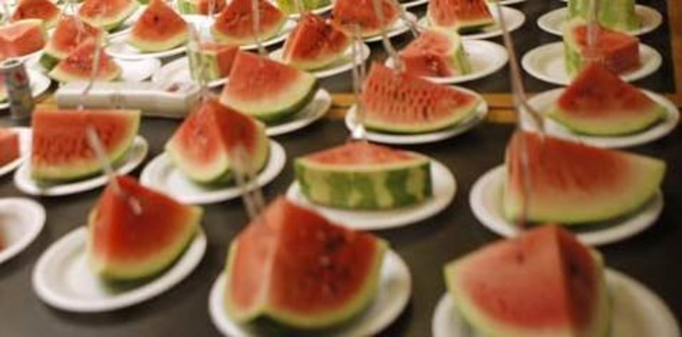 Photo - Plates of watermelon. Photo by Garett Fisbeck, The Oklahoman