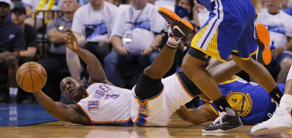 Photo - Oklahoma City's Dion Waiters (3) passes the ball from the ground during Game 3 of the Western Conference finals in the NBA playoffs between the Oklahoma City Thunder and the Golden State Warriors at Chesapeake Energy Arena in Oklahoma City, Sunday, May 22, 2016. Oklahoma City won 133-105. Photo by Bryan Terry, The Oklahoman
