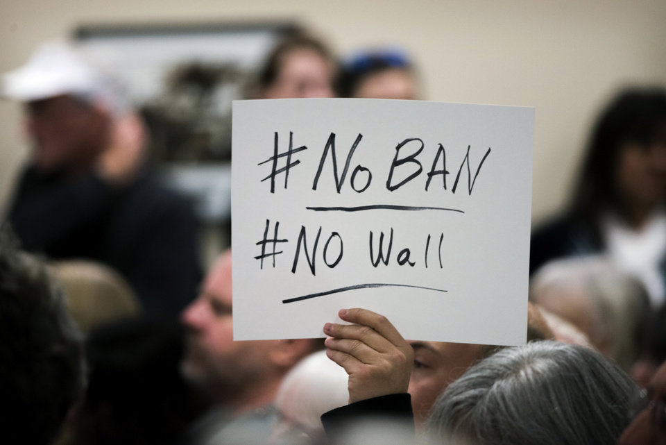 Photo - A sign is displayed at a town hall meeting held by Rep. Ami Bera at Elk Grove City Hall on Saturday, Jan. 28, 2017, to talk about their concerns with the new Trump administration and wanting to know that Bera would work in Washington against many aspects of the administration's agenda, including current new policies on immigration, the Affordable Health Care Act and more.  (Autumn Payne /The Sacramento Bee via AP)