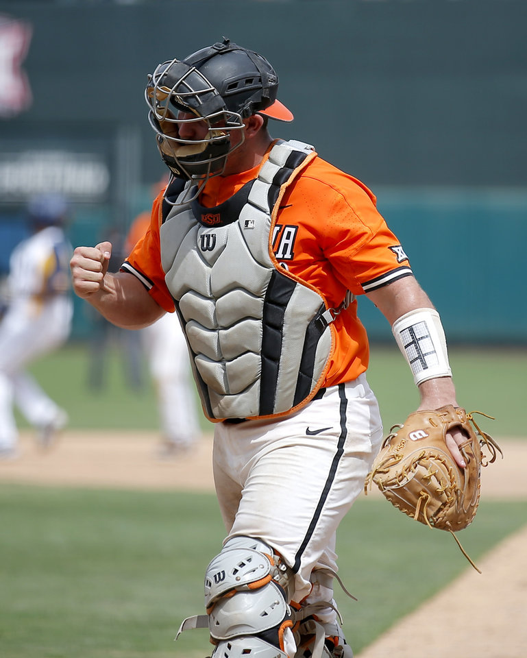 Photo - OSU's Colin Simpson celebrates an out in the 8th inning during the Big 12 baseball tournament game between Oklahoma State and West Virginia at the Chickasaw Bricktown Ballpark in Oklahoma City, Sunday, May 26, 2019.  [Sarah Phipps/The Oklahoman]