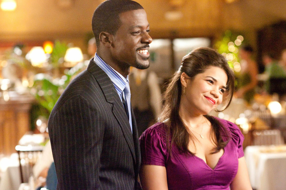 "Photo - Lance Gross and America Ferrera share a scene in ""Our Family Wedding.""  Fox Searchlight Photo"