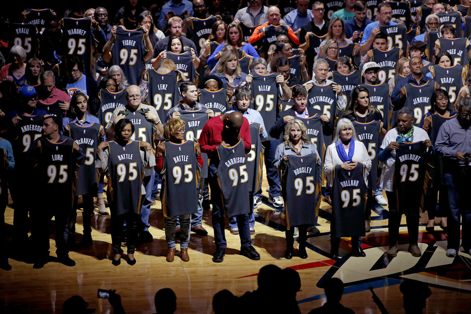 Photo - Family members of victims of the Oklahoma  bombing hold personalized Oklahoma City Thunder jerseys that they received before an NBA basketball game between the Oklahoma City Thunder and the Orlando Magic at Chesapeake Energy Arena in Oklahoma City, Tuesday, Nov. 5, 2019. [Bryan Terry/The Oklahoman]