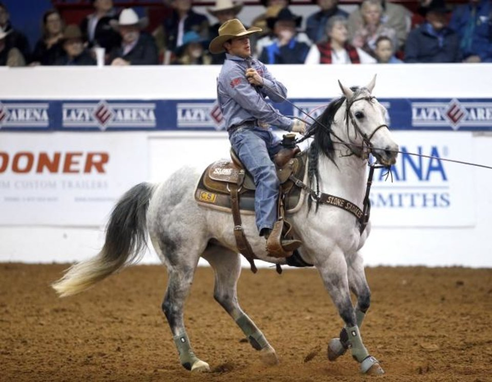 Photo -  Broken Bow native Clay Smith and his horse, Marty, participate in the heading event at the 2020 Cinch Timed Event Championship at the Lazy E Arena in Guthrie on Saturday. [Sarah Phipps/The Oklahoman]