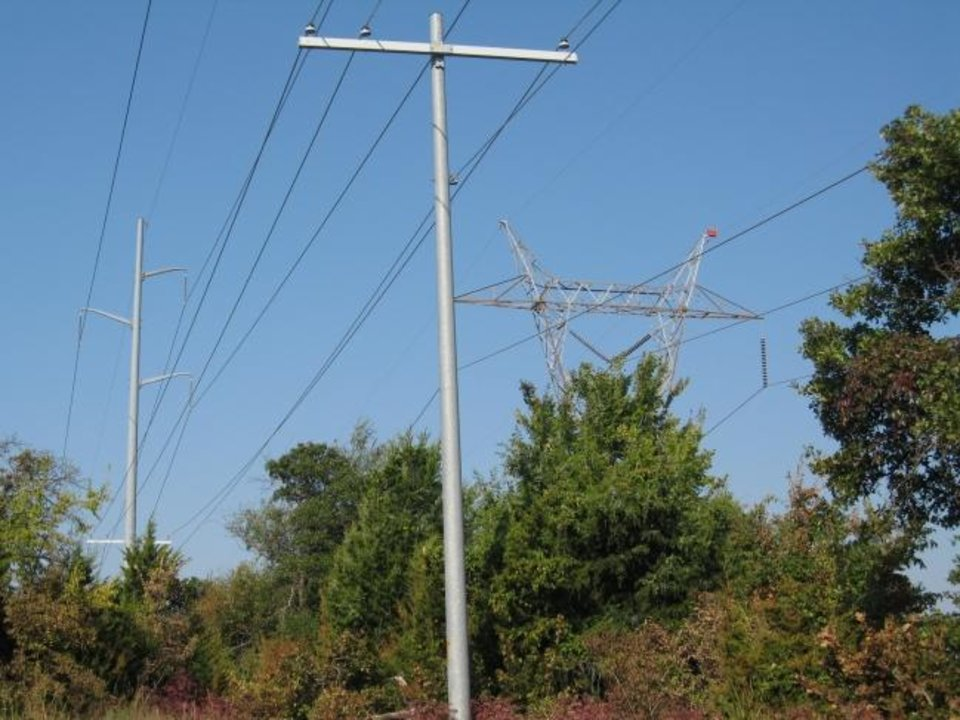 Photo -  Lines carrying both transmitted and distributed electricity are seen in north Edmond. [OKLAHOMAN ARCHIVES]