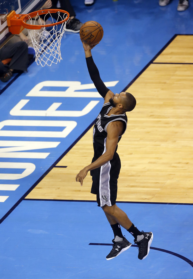 Photo - San Antonio's Patty Mills (8) shoots a lay up during Game 4 of the Western Conference semifinals between the Oklahoma City Thunder and the San Antonio Spurs in the NBA playoffs at Chesapeake Energy Arena in Oklahoma City, Sunday, May 8, 2016. Photo by Sarah Phipps, The Oklahoman