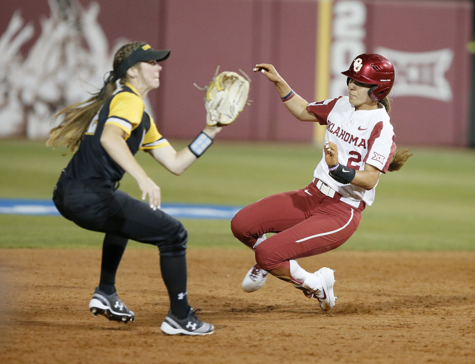 Photo - Oklahoma's Sydney Romero (2) slides past UMBC's Maddie Daigneau (22) to second base in the fourth inning of the Norman Regional NCAA softball tournament game between the University of Oklahoma (OU) and UMBC in Norman, Okla., Friday, May 17, 2019. Oklahoma won 12-0.  [Bryan Terry/The Oklahoman]