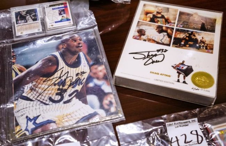 Photo -  A Shaquille O'Neal basketball card is one of many sports trading cards that will be auctioned off next week among many items found in more than 600 abandoned safe deposit boxes.