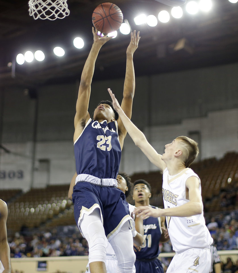 Photo - Heritage Hall's Trey Alexander goes to the basket beside Broken Bow's Jace Jordan during a Class 4A state tournament basketball game between Heritage Hall and Broken Bow High School in Jim Norick Arena at State Fair Park in Oklahoma City, Thursday, March 7, 2019. Photo by Bryan Terry, The Oklahoman