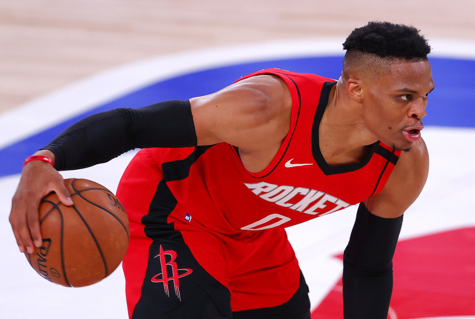 Photo - Aug 2, 2020; Lake Buena Vista, USA; Russell Westbrook #0 of the Houston Rockets moves the ball against the Milwaukee Bucks at The Arena at ESPN Wide World Of Sports Complex on August 02, 2020 in Lake Buena Vista, Florida. Mandatory Credit: Mike Ehrmann/Pool Photo via USA TODAY Sports