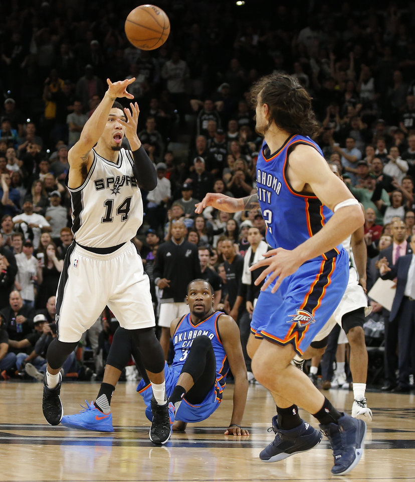 Photo - San Antonio's Danny Green (14) passes the ball as Oklahoma City's Steven Adams (12) defends in the final seconds of Game 2 of the second-round series between the Oklahoma City Thunder and the San Antonio Spurs in the NBA playoffs at the AT&T Center in San Antonio, Monday, May 2, 2016. Oklahoma City won 98-97. Photo by Bryan Terry, The Oklahoman