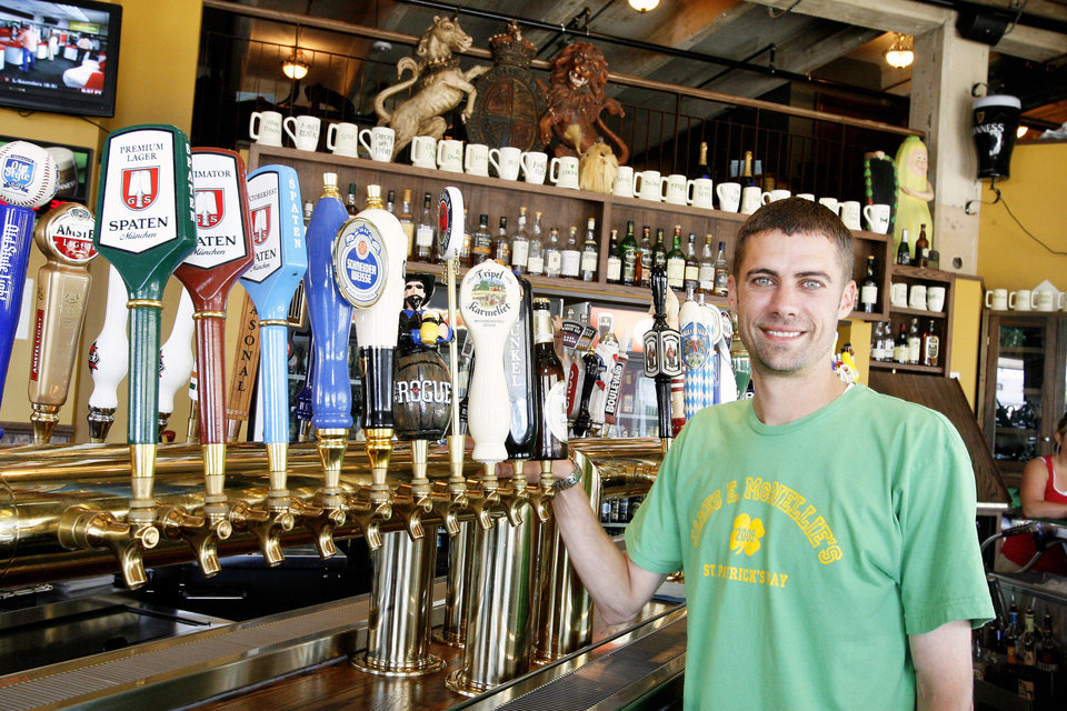 Jake Hickman, Bar Manager, Stands By Beer Taps Wednesday At James E. Mc  Bar Manager