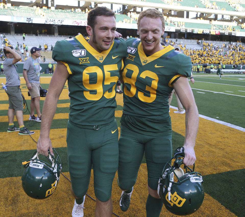Photo - Baylor place kicker John Mayers, left, walks off with teammate Russell Morrison after defeating Iowa State in the second half of an NCAA college football game, Saturday, Sept. 28, 2019, in Waco, Texas. Mayers had the game winning field goal late in the game. (Rod Aydelotte/Waco Tribune-Herald via AP)