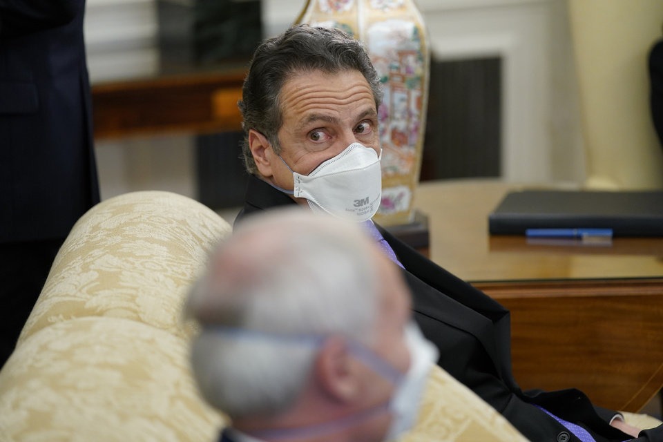 Photo -  New York Gov. Andrew Cuomo attends a meeting with President Joe Biden and a bipartisan group of mayors and governors to discuss a coronavirus relief package, in the Oval Office of the White House, Friday, Feb. 12, 2021, in Washington. (AP Photo/Evan Vucci)