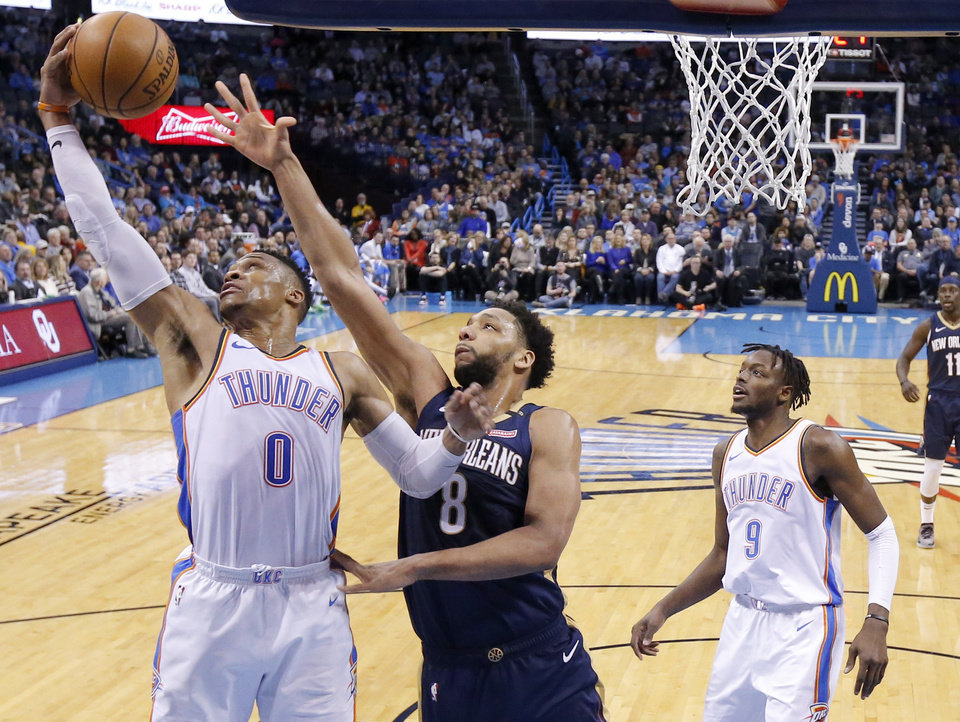 Photo - Oklahoma City's Russell Westbrook (0) goes for a rebound beside New Orleans' Jahlil Okafor (8) during an NBA basketball game between the Oklahoma City Thunder and the New Orleans Pelicans at Chesapeake Energy Arena in Oklahoma City, Thursday, Jan. 24, 2019. Photo by Bryan Terry, The Oklahoman