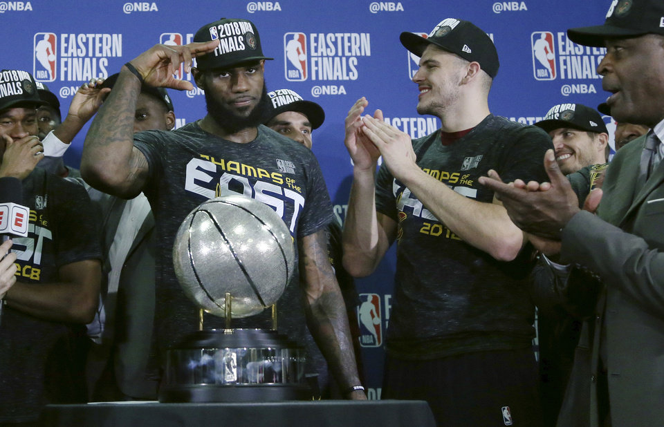 f32c38fa9d55 Cleveland Cavaliers forward LeBron James salutes after his team was  presented the trophy for beating the Boston Celtics 87-79 in Game 7 of the  NBA ...