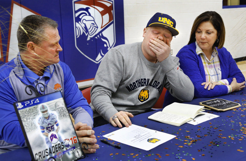 Photo -  Christian Heritage Academy offensive lineman Kyle Ergenbright fights back emotions after signing his letter of intent with Northern Colorado on Wednesday. [PHOTO BY JIM BECKEL, THE OKLAHOMAN]