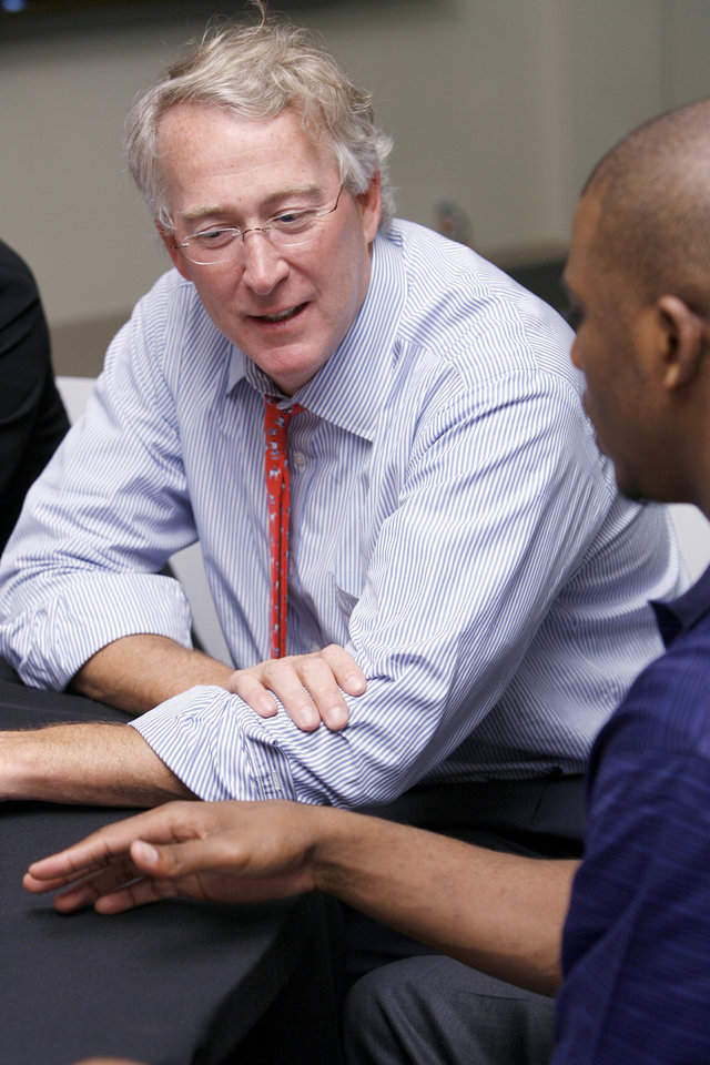 Photo - Chesapeake Energy CEO and chairman Aubrey McClendon, left, talks with Chris Paul of the New Orleans Hornets NBA basketball team during an event for new Chesapeake Energy interns at the the Oklahoma Heritage Center in Oklahoma City, Tuesday, June 5, 2007. This was one of Paul's last appareances in Oklahoma City. By Nate Billings, The Oklahoman ORG XMIT: KOD