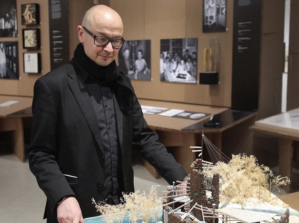Photo - Hans Butzer looks at a model of the Bavinger House in the exhibit