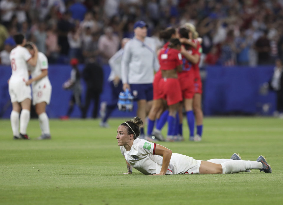 Photo - England's Lucy Bronze lies on the pitch in dejection at the end of the Women's World Cup semifinal soccer match between England and the United States, at the Stade de Lyon outside Lyon, France, Tuesday, July 2, 2019. (AP Photo/Laurent Cipriani)