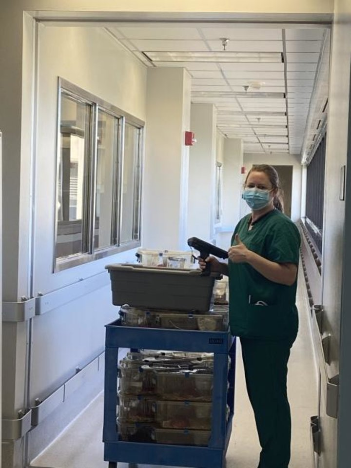 Photo -  A technician who is part of the skeleton crew at Oklahoma Medical Research Foundation tends to her chores. [Photo Provided]